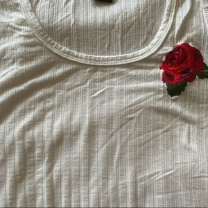 With tank with red rose